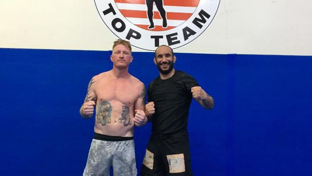 Ed Herman, left, with one of his training partners at his home gym. Herman features in a preliminary bout of UFC 265 Saturday night on pay-per-view. (Courtesy of Ed Herman)